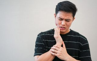 Young man experiencing pain from wisdom teeth