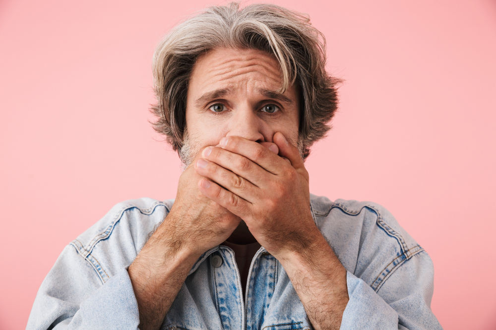 Man covering mouth (Bad Breath What Causes it and What to Do About it)